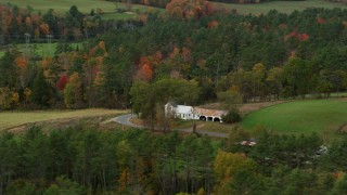 AX150_281 - 6K stock footage aerial video flying by an isolated home and colorful foliage in autumn, Bath, New Hampshire
