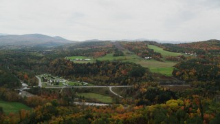 AX150_282 - 6K stock footage aerial video flying by Twin River Campground & Cottages, small farms, autumn, Bath, New Hampshire