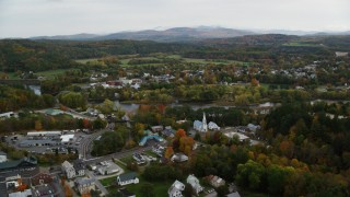 AX150_289 - 6K stock footage aerial video flying by small rural town, colorful foliage, autumn, Woodsville, New Hampshire and Wells River, Vermont