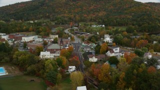 AX150_294 - 6K stock footage aerial video flying over small town, approach Bath-Haverhill Bridge, autumn, Woodsville, New Hampshire