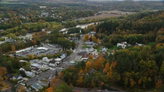 AX150_298 - 6K stock footage aerial video orbiting small rural towns, Connecticut River, autumn, overcast, Wells River, Vermont