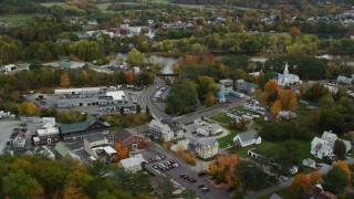 AX150_299 - 6K stock footage aerial video of small rural towns, car dealership near Connecticut River, autumn, Wells River, Vermont