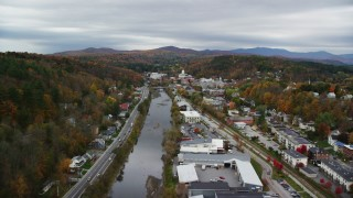 AX150_353 - 6K stock footage aerial video flying over Winooski River, approach downtown, autumn, Montpelier, Vermont