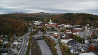 AX150_354 - 6K stock footage aerial video flying over Winooski River, approach downtown, Vermont State House, autumn, Montpelier, Vermont