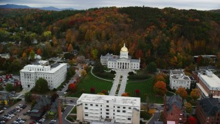 AX150_355 - 6K stock footage aerial video orbiting Vermont State House, downtown, autumn, Montpelier, Vermont