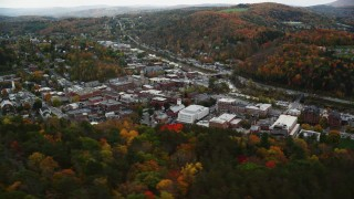 AX150_357 - 6K stock footage aerial video flying by downtown buildings, colorful trees, autumn, Montpelier, Vermont