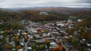 AX150_359 - 6K stock footage aerial video flying by downtown buildings, colorful foliage, overcast, autumn, Montpelier, Vermont