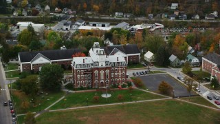 AX150_360 - 6K stock footage aerial video flying by Vermont College of Fine Arts, autumn, Montpelier, Vermont