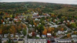 AX150_375 - 6K stock footage aerial video flying by neighborhood, Vermont College of Fine Arts, autumn, Montpelier, Vermont