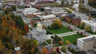 AX150_382 - 6K stock footage aerial video orbiting Vermont State House, lawns, trees in autumn, Montpelier, Vermont