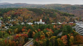 AX150_385 - 6K stock footage aerial video flying by Vermont State House, revealing office buildings, autumn, Montpelier, Vermont