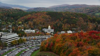 AX150_386 - 6K stock footage aerial video flying by office building, Vermont State House, autumn, Vermont State House