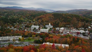 AX150_387 - 6K stock footage aerial video approaching Vermont State House, buildings, foliage in autumn, Montpelier, Vermont