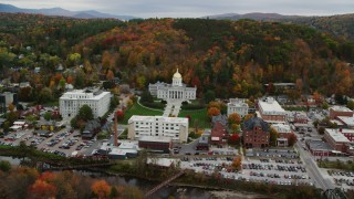 AX150_388 - 6K stock footage aerial video approaching Vermont State House, downtown, colorful trees in autumn, Montpelier, Vermont