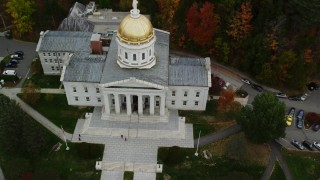 AX150_389 - 6K stock footage aerial video approaching Vermont State House, tilt down, autumn, Montpelier, Vermont