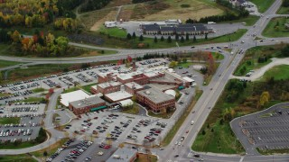 AX150_396 - 6K stock footage aerial video flying by Central Vermont Medical Center, tilt down, autumn, Barre, Vermont