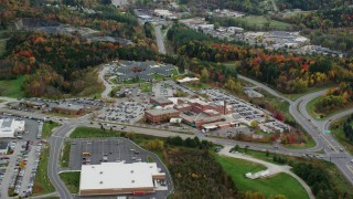 AX150_398 - 6K stock footage aerial video flying away from Central Vermont Medical Center, autumn, Barre, Vermont