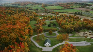 AX150_408 - 6K stock footage aerial video orbiting cemetery, colorful trees in autumn, Randolph Center, Vermont