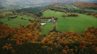 AX150_410 - 6K stock footage aerial video approaching Silloway Road, farms, colorful trees in autumn Randolph Center, Vermont
