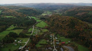 AX150_418 - 6K stock footage aerial video approaching and flying over Route 14, small rural town in autumn, Bethel, Vermont