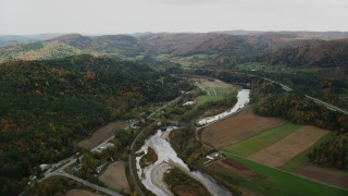 AX150_424 - 6K stock footage aerial video flying over small farms, White River, Route 14 in autumn, South Royalton, Vermont