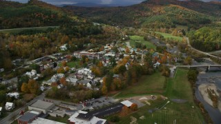 AX150_431 - 6K stock footage aerial video orbiting small rural town along the White River, autumn, South Royalton, Vermont