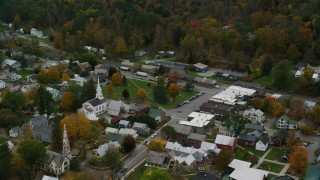 AX150_446 - 6K stock footage aerial video orbiting church, town square, small rural town in autumn, South Royalton, Vermont