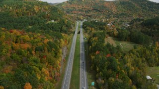 AX150_453 - 6K stock footage aerial video flying over interstate 89 through colorful trees in autumn, Sharon, Vermont