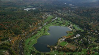 AX150_467 - 6K stock footage aerial video flying over Lakeland Golf Course, Lake Pinneo, autumn, Quechee, Vermont