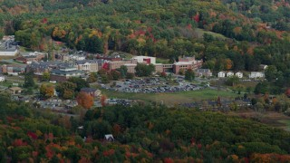 AX150_472 - 6K stock footage aerial video flying by White River Junction VA Medical Center, autumn, White River Junction, Vermont