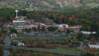 AX150_473 - 6K stock footage aerial video of White River Junction VA Medical Center, colorful trees, autumn, White River Junction, Vermont