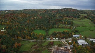 AX151_001 - 6K stock footage aerial video flying over Hartland Road, approach colorful forested hills, autumn, White River Junction, Vermont