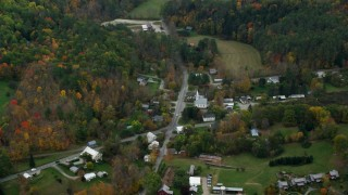 AX151_044 - 6K stock footage aerial video flying by Skunk Hollow Road, Mace Hill Road, autumn, Hartland, Vermont