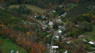 AX151_045 - 6K stock footage aerial video flying by church, Skunk Hollow Road, Mace Hill Road, autumn, Hartland, Vermont