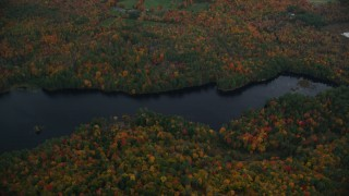 AX151_075 - 6K stock footage aerial video of a bird's eye view over Red Leaf Pond, colorful forest, autumn, Croydon, New Hampshire