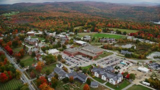 AX151_099 - 6K stock footage aerial video orbiting Colby Sawyer College, colorful foliage, autumn, New London, New Hampshire