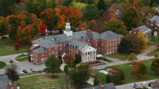 AX151_100 - 6K stock footage aerial video orbiting Colgate Hall, Colby Sawyer College, autumn, New London, New Hampshire