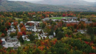 AX151_103 - 6K stock footage aerial video flying by First Baptist Church, Colby Sawyer College, autumn, New London, New Hampshire