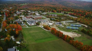 AX151_104 - 6K stock footage aerial video orbiting Colby Sawyer College in autumn, New London, New Hampshire
