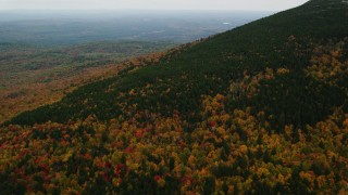 AX151_112 - 6K stock footage aerial video flying over colorful forest, Mount Kearsarge, autumn, Wilmot, New Hampshire
