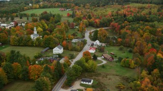 AX151_133 - 6K stock footage aerial video orbiting a small town, church, colorful foliage in autumn, Webster, New Hampshire