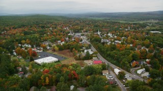 AX151_144 - 6K stock footage aerial video flying by Main Street, small town neighborhood, autumn, Penacook, New Hampshire