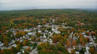 AX151_145 - 6K stock footage aerial video orbiting churches, small town neighborhood, autumn, Penacook, New Hampshire