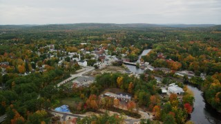 AX151_147 - 6K stock footage aerial video orbiting small town, Contoocook River, autumn, Penacook, New Hampshire