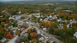 AX151_150 - 6K stock footage aerial video orbiting church near Main Street, small town, autumn, Penacook, New Hampshire