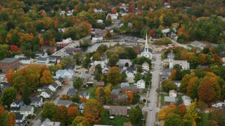 AX151_151 - 6K stock footage aerial video orbiting church, colorful foliage, small town, autumn, Penacook, New Hampshire