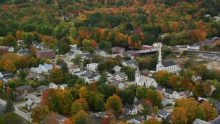 AX151_152 - 6K stock footage aerial video orbiting and flying away from a church, small town in autumn, New Hampshire