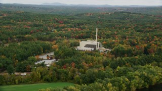 AX151_153 - 6K stock footage aerial video flying by factory, smoke stack, colorful trees in autumn, Penacook, New Hampshire