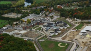 AX151_160 - 6K stock footage aerial video orbiting New Hampshire State Prison, baseball field, autumn, Concord, New Hampshire