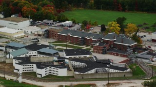 AX151_173 - 6K stock footage aerial video orbiting the New Hampshire State Prison, autumn, Concord, New Hampshire
